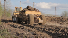 Construction - Earth Mover Passing with load. Stock Footage