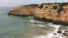 Natural rocks at Praia Albandeira in the Algarve Portugal Stock Footage