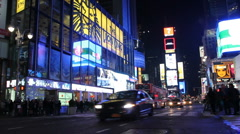 Stock Video Footage of Times Square, Manhattan, New York City. Advertisements and traffic -V.2