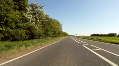 Driving along a main road in Rural Oxfordshire, following the guidelines Stock Footage