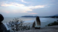 Stock Video Footage of A meditative and romantic blonde girl relaxing waching the sea