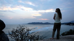 A meditative and romantic blonde girl relaxing waching the sea Stock Footage