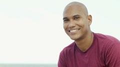 Young latino man smiling at camera Stock Footage