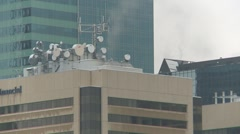 Microwave dishes on office tower rooftop Stock Footage