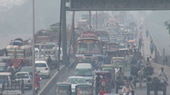 Traffic jam, exhaust fumes, smog, bridge in Lahore, Pakistan Stock Footage