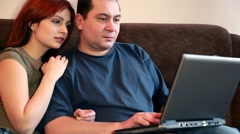 Stock Video Footage of man is typing on notebook and woman watching