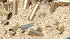 Pistol bullet cartridge brass close cleaning P HD 8316 Stock Footage