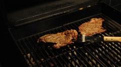 Medium Ribeye Seak on a BBQ Grill Stock Footage