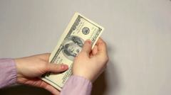 A business woman counting American dollars for a transaction - stock footage