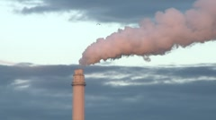 Flue gas from a chimney in a power plant. The movement of the gas and the clouds Stock Footage