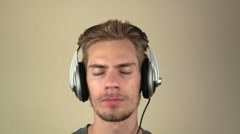 Young man listening to headphones Stock Footage