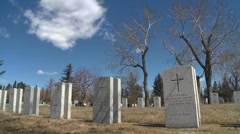 Dolly shot time-lapse, war graves early spring, #2 wide shot Stock Footage