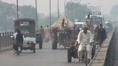 Diverse traffic on old Lahore bridge, third world, Pakistan Stock Footage