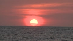 Sun sets in the distance in Puerto Vallarta, Mexico, at a beach resort. Orange Stock Footage