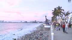 Malecon in Puerto Vallarta, Mexico. We see the sculptures on the beach walk, the Stock Footage