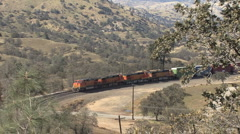 Train moves into the Tehachapi Loop Stock Footage