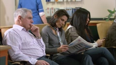 Patients waiting in waiting room Stock Footage