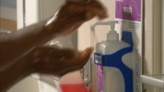 Male hands getting soap from dispenser Stock Footage