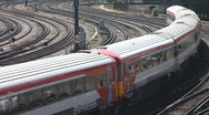 Stock Video Footage of Electric express and commuter trains rounds a curve to leave London