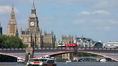 London Big Ben Houses of Parliament boat approaches Lambeth Bridge Stock Footage