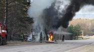 Extinguishing of the burning bus Stock Footage