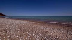 Peaceful Waves on Rocky Beach 2 - slow pan left to right Stock Footage