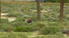 Camera Tracks Group Of Desert Motorcycle Riders Stock Footage