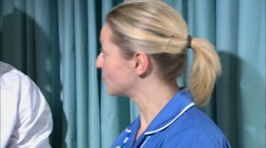 Doctor and nurse in ward in hospital - stock footage