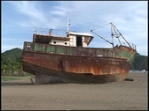 Shipwreck on beach Stock Footage