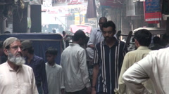 Pakistan, horse cart, people, walking through mysterious looking alley Stock Footage