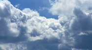 Cumulus clouds passing by on closeup Stock Footage