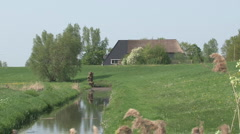 Landscape, river and people on bicycle Stock Footage