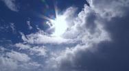 Sun shining through clouds Stock Footage