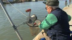 Italy Po delta fishman and net Stock Footage