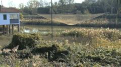 Italy Po delta fishing nets zoom Stock Footage