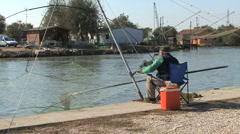 Italy Po delta fisheman drops net Stock Footage