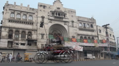 Beautiful old building and traffic in Pakistan Stock Footage