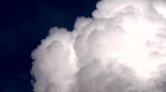 Stylized time-lapse clouds, deep blue sky.  Seamless loop Stock Footage