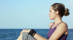 Portrait of beautiful woman contemplating the sea Stock Footage