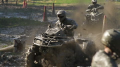 Mud racing with ATVs Stock Footage