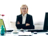 Portrait of happy businesswoman with crossed hands in the office Stock Footage