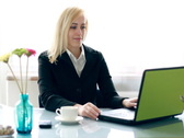 Young businesswoman drinking coffee and smiling to camera NTSC Stock Footage