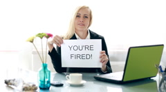 Businesswoman gets paper sheet with YOU`RE FIRED text HD - stock footage
