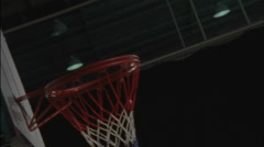 Athlete landing a offensive rebound and scoring in a game of basketball. Stock Footage