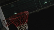 Stock Video Footage of Athlete landing a offensive rebound and scoring in a game of basketball.