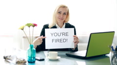 Serious businesswoman showing paper sheet with YOU`RE FIRED sign HD - stock footage