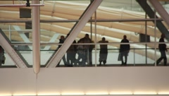 People walking across catwalk in convention center(HD)c Stock Footage