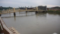 Yellow bridges and buildings along the Allegheny River in Pittsburgh, PA - stock footage