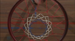 A basketball player shoots and sinks a ball. Stock Footage