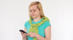 Portrait of attractive woman texting, sending sms, isolated HD Stock Footage
